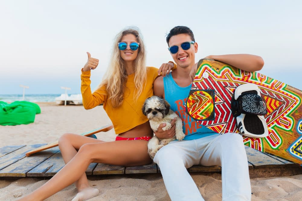 Young Smiling Couple Having Fun Beach With Kite Surfing Board Summer Vacation